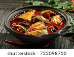 spicy homemade fish curry in... | Shutterstock . vector #722098750