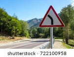 Small photo of warning sign for abrupt turn and turn of the road