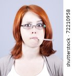 Young businesswomen with thermometer in mouth - stock photo