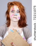 Red-haired businesswoman with book and notes on face. - stock photo