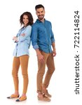 Small photo of full body of a back to back casual couple smiling on white background, woman with hands crossed