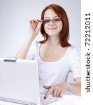 Red-haired girl with white notebook. Studio shot. - stock photo