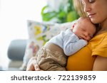 young mother  holding tenderly... | Shutterstock . vector #722139859