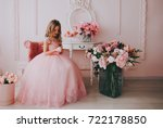 Stock photo little cute princess girl in pink dress in pink room 722178850