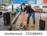 man waiting for luggage from... | Shutterstock . vector #722188693