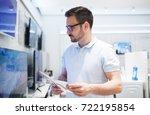 man at tech store shopping new...   Shutterstock . vector #722195854
