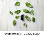 bottle with basil oil and green ... | Shutterstock . vector #722221600