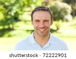 man smiling in the park | Shutterstock . vector #72222901