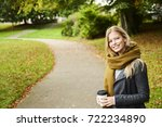smiling beautiful woman in park ... | Shutterstock . vector #722234890