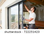 handsome young man installing... | Shutterstock . vector #722251423