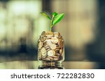 plant growing out of coins with ... | Shutterstock . vector #722282830