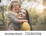 mother and daughter on meadow.... | Shutterstock . vector #722362336
