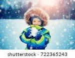 baby boy walking at snowfall....   Shutterstock . vector #722365243