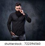 stylish bearded male in a black ...   Shutterstock . vector #722396560