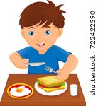 happy boy eating at the table | Shutterstock . vector #722422390