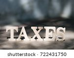 high angle view of  tax word on ... | Shutterstock . vector #722431750