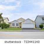 beautiful yellow suburban home...   Shutterstock . vector #722441143