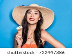 smiling asian woman in beach... | Shutterstock . vector #722447386