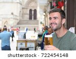 happy man holding his cold...   Shutterstock . vector #722454148