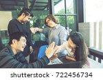 asian freelance team happiness... | Shutterstock . vector #722456734