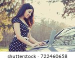 smiling young woman using... | Shutterstock . vector #722460658