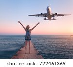 airplane and woman at sunset....   Shutterstock . vector #722461369