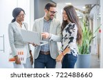 group of three business people... | Shutterstock . vector #722488660
