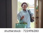 smiling african woman walking... | Shutterstock . vector #722496283