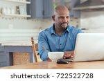 smiling mature african man... | Shutterstock . vector #722522728