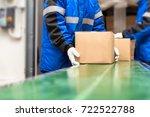 package boxes on conveyor belt... | Shutterstock . vector #722522788