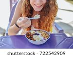 acai bowl woman eating morning... | Shutterstock . vector #722542909