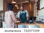 smiling barista using nfs... | Shutterstock . vector #722577259