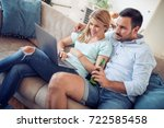 young couple sitting in the... | Shutterstock . vector #722585458