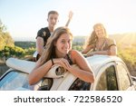 group of happy people in a car... | Shutterstock . vector #722586520