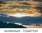 Small photo of Paragliding, powered paraglider and opportunity to admire sunset over land, but requires absence of thermals (anabatic wind) because of danger of collapse, air sports, entertainment