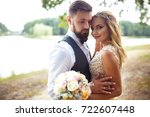 stylish couple of happy... | Shutterstock . vector #722607448