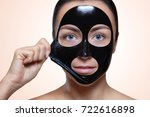 a black mask to the face of a... | Shutterstock . vector #722616898
