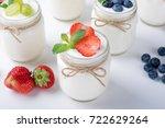 fresh yogurt with berries in... | Shutterstock . vector #722629264