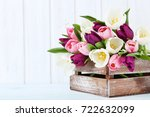 bouquet of tulips on a wall... | Shutterstock . vector #722632099