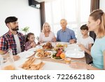 the family sits at a festive... | Shutterstock . vector #722662180