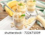 glasses with delicious banana...   Shutterstock . vector #722671039