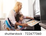 the girl and her grandmother... | Shutterstock . vector #722677360