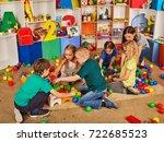 children building blocks in... | Shutterstock . vector #722685523