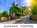 cozy street of old montmartre... | Shutterstock . vector #722699386
