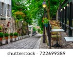 street with tables of cafe in... | Shutterstock . vector #722699389
