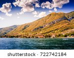 lake como. people on a boat... | Shutterstock . vector #722742184
