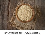 brown rice in a bowl on wooden  ... | Shutterstock . vector #722838853