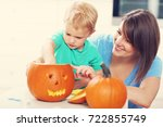 mother and son preparing jack o ...   Shutterstock . vector #722855749