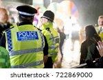 police officers provide... | Shutterstock . vector #722869000