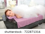 young woman covered with foam... | Shutterstock . vector #722871316